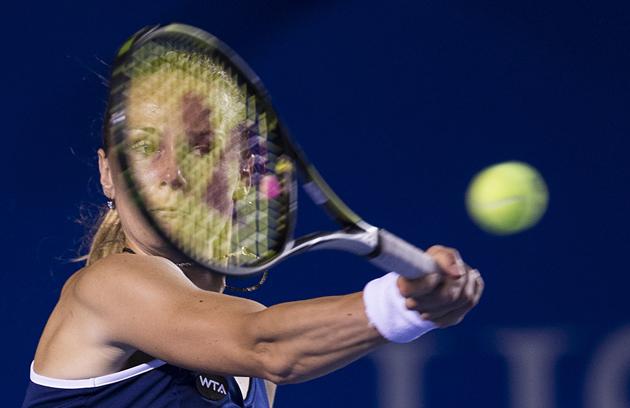 Magdalena Rybarikova returns the ball to Sharapova during the Mexican Open.