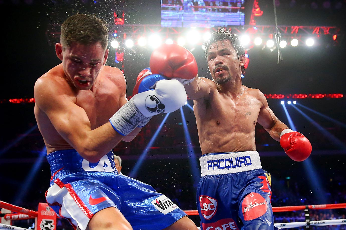 Manny Pacquiao lands a punch on Chris Algieri during the WBO world welterweight title at The Venetian in Macau.