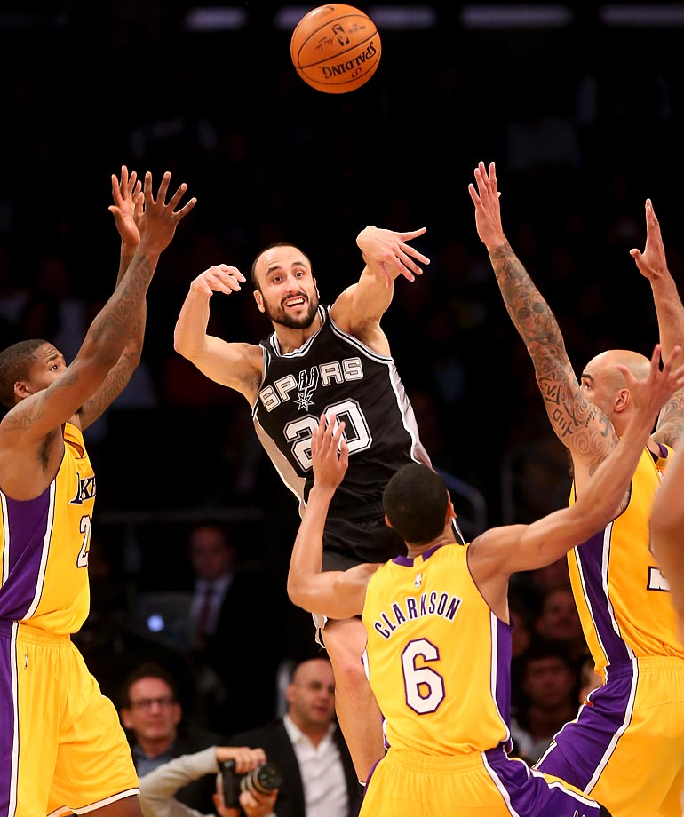 The San Antonio Spurs' Manu Ginobili throws a pass over the Los Angeles Lakers' Jordan Clarkson. The Spurs defeated the Lakers 93-80 at the Staples Center.