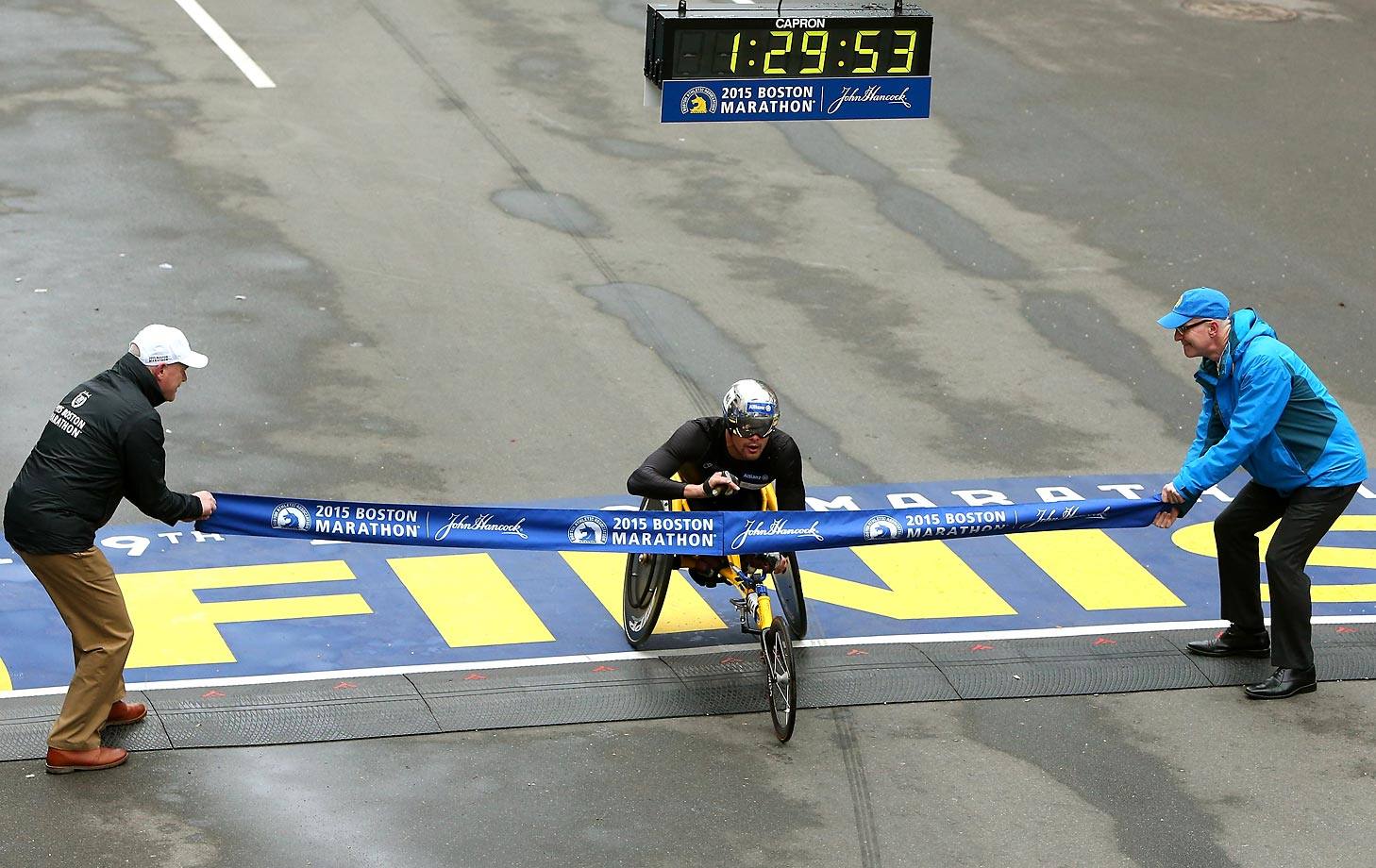 Marcel Hug of Switzerland crosses the finish line to win the men's push rim wheelchair division.