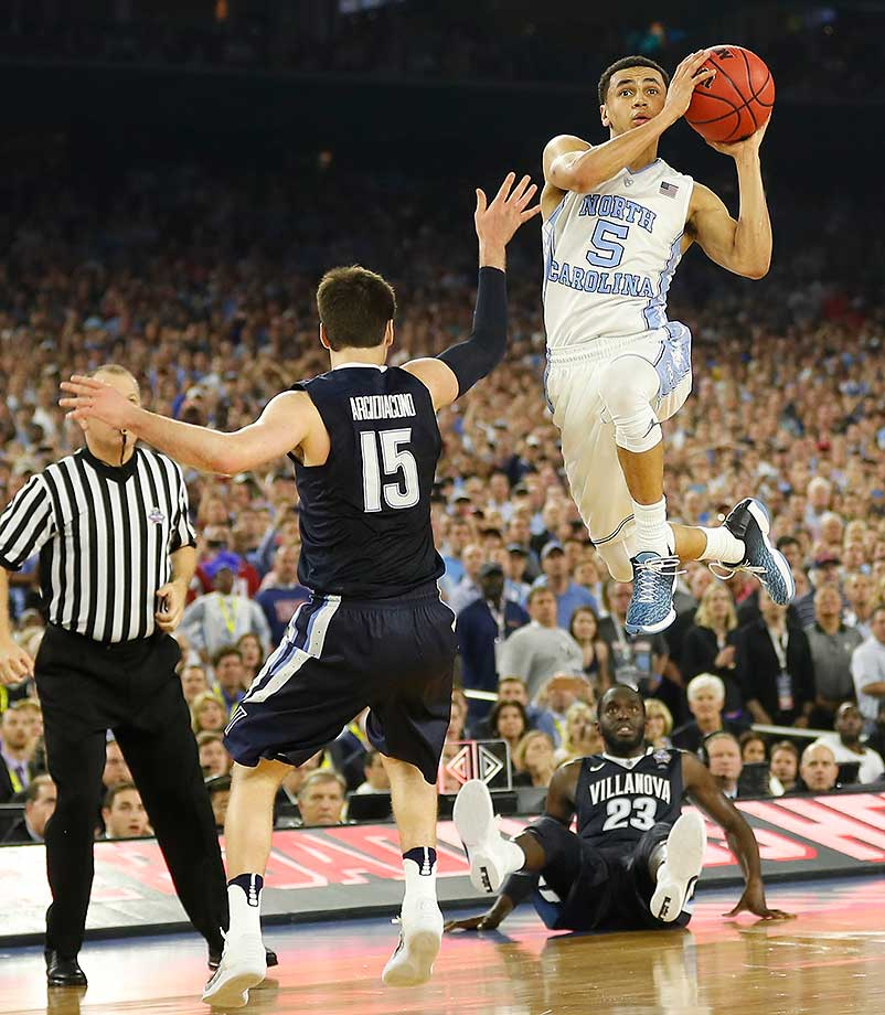 if not for the buzzer-beater by Kris Jenkins, this game-tying three-point shot by Marcus Paige of North Carolina figured to send the game into overtime. The Tar Heels hit 11 of their 17 three-point attempts. (Go to si.com/photos to see the full national title game gallery.)