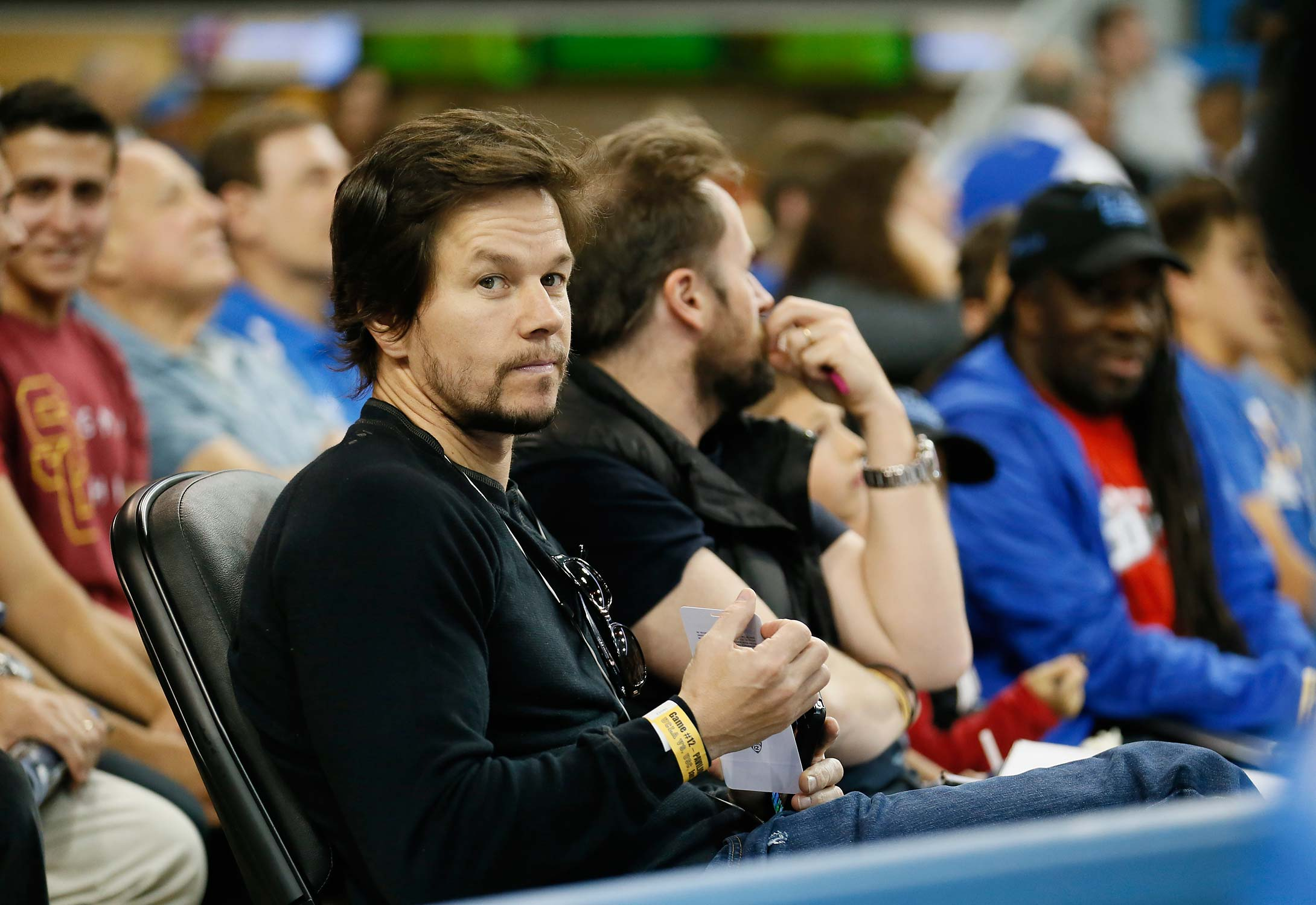 Mark Wahlberg sits courtside during a 2014 game between Southern California and UCLA in Los Angeles.
