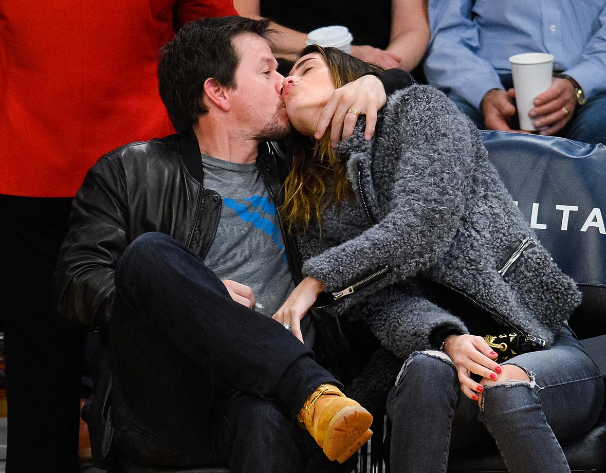 Mark Wahlberg seems to miss the kiss from his wife, Rhea, while at a game between the Bucks and Lakers.