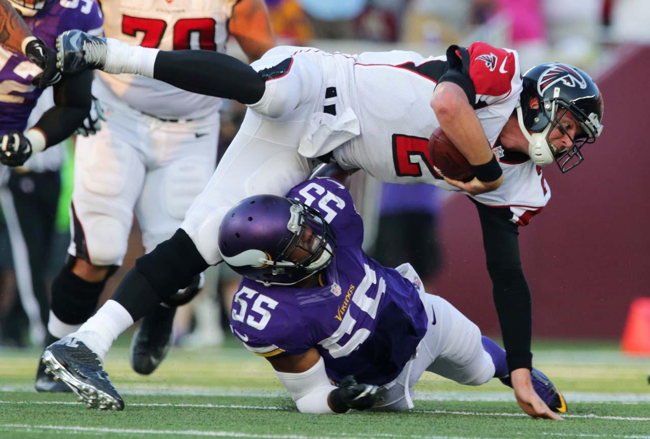 Minnesota Vikings outside linebacker Anthony Barr tackles Atlanta Falcons quarterback Matt Ryan in Minneapolis.
