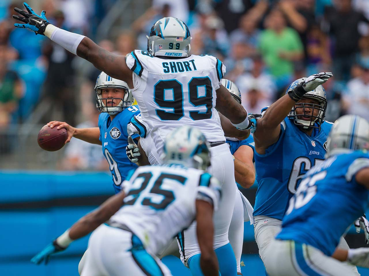 Kawaan Short pressures Detroit quarterback Matthew Stafford during the Panthers' 24-7 victory.