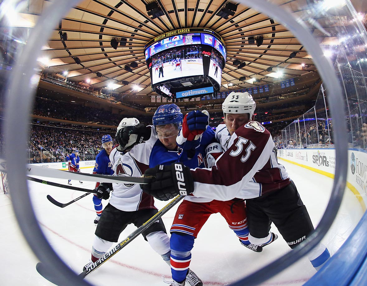 Maxime Talbot and Cody McLeod of the Colorado Avalanche combine to hit Jesper Fast of the New York Rangers at Madison Square Garden. The Avalanche defeated the Rangers 4-3 in the shootout.