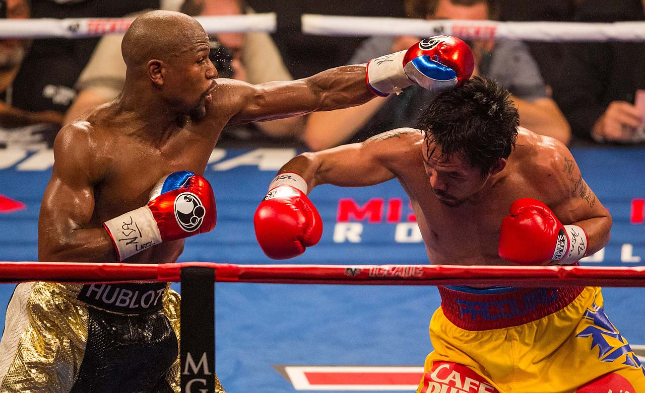The crowd of 16,507 cheered nearly every time Pacquiao threw a punch. (AP)