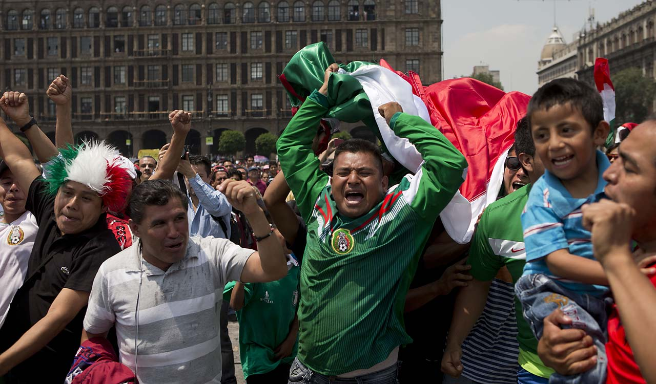 Soccer fans In Mexico City celebrate a goal by striker Oribe Peralta against Cameroon.