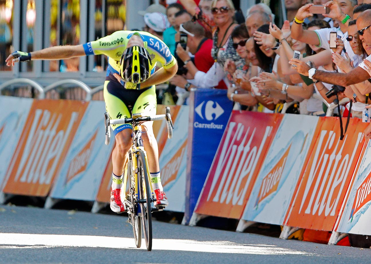 Australia's Michael Rogers takes a bow on his bicycle as he crosses the finish line to win the 16th stage of the Tour de France in Bagneres-de-Luchon, France.