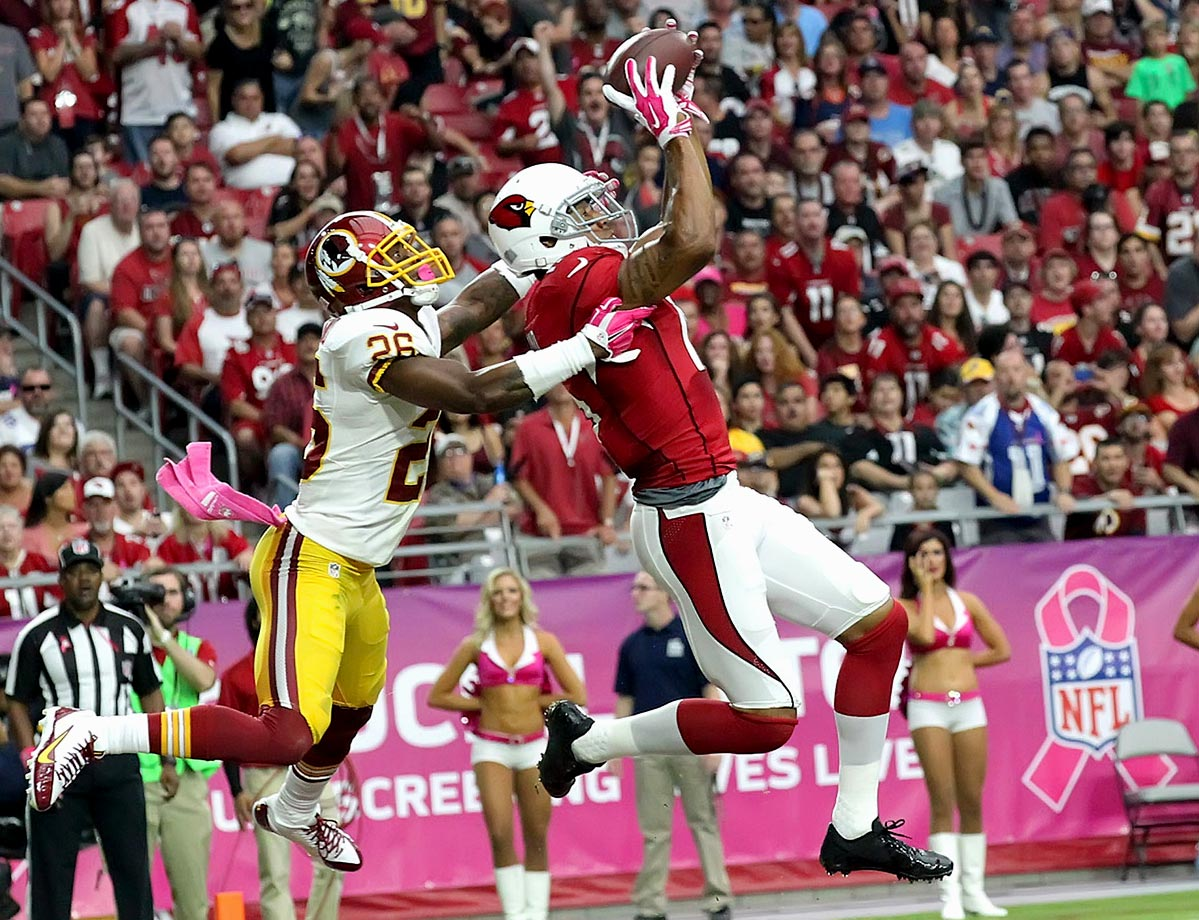Michael Floyd of the Arizona Cardinals hauls in a 20 yard touchdown catch against Bashaud Breeland of the Arizona Cardinals in the first quarter.