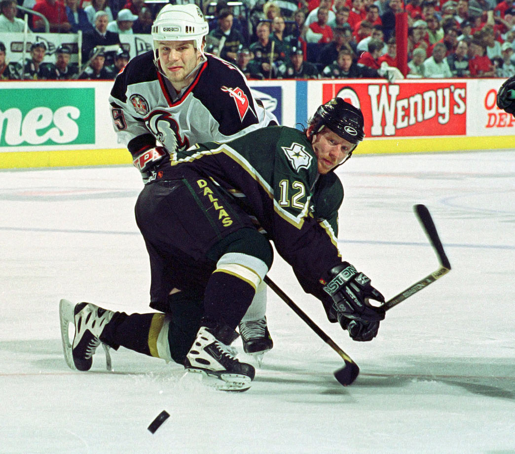 The hardworking winger was a key part of Montreal's '93 Cup champs, and later donned the Habs' C, before he was traded with Patrick Roy to Colorado during the Avs' 1995-96 Cup season. The Stars acquired him from the Rangers before the '98 deadline. A year later, Keane gave Dallas a dose of indispensable grit during the Stars' Cup run in '99.