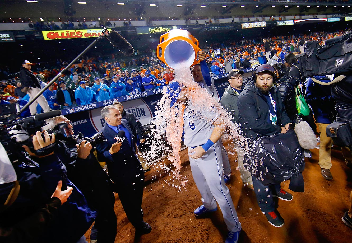 Mike Moustakas of the Royals is showered by Salvador Perez after Kansas City defeated the Baltimore Orioles on Saturday.
