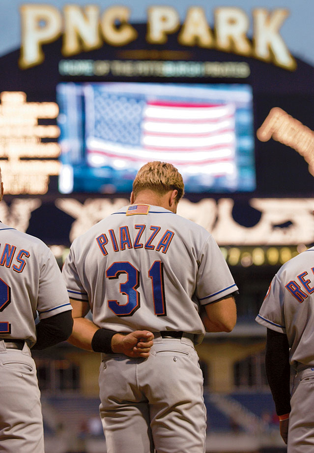 Mike Piazza bows his head during ''God Bless America'' at PNC Park before the New York Mets game against the Pittsburgh Pirates.  It was the first day baseball resumed since 9/11.