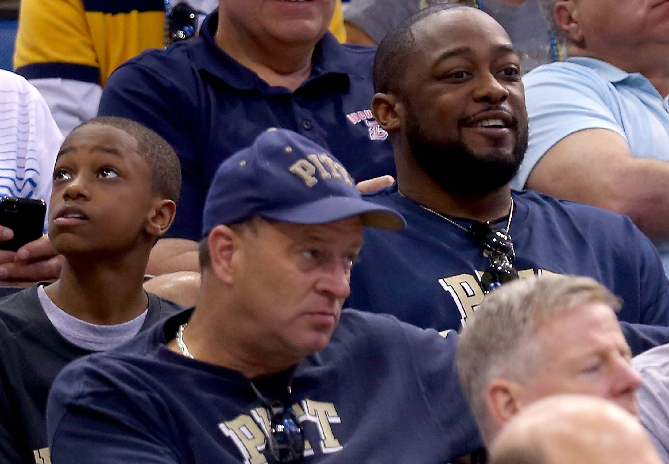 Pittsburgh Steelers head coach Mike Tomlin with his son as the Pitt Panthers take on the Florida Gators during the third round of the 2014 tournament at Amway Center in Orlando.