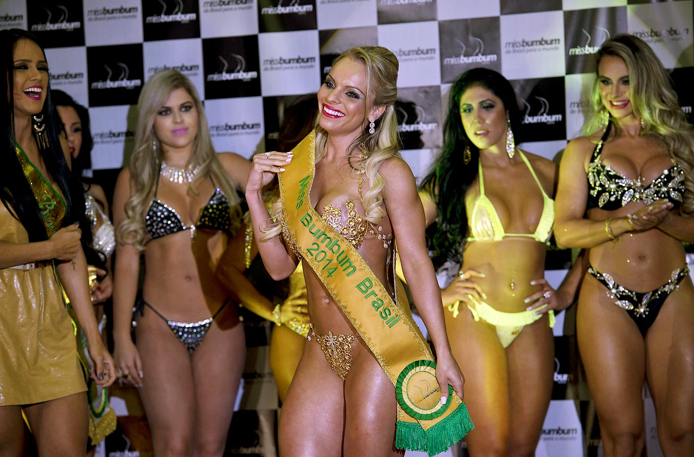 Indianara Carvalho after winning the Miss Bumbum Brazil 2014 pageant in Sao Paulo.  Carvalho, a curvy model from the south state of Santa Catarina, was crowned Miss Bumbum, a title rewarding Brazil's sexiest female derriere. You can't make this stuff up.