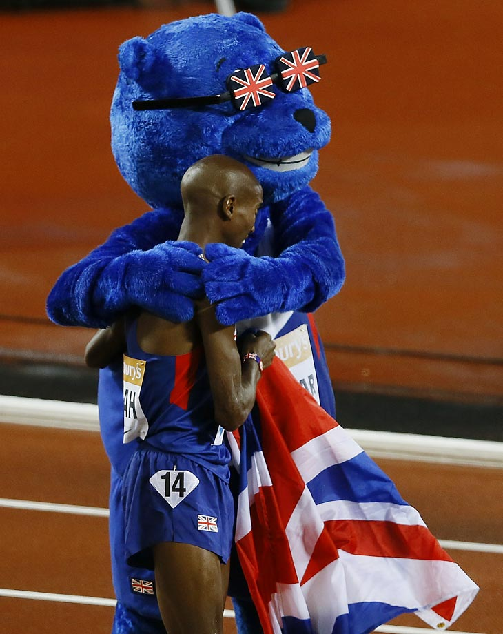 Mo Farah of Britain celebrates with the mascot after winning the 3000m race at the Diamond League athletics meet in London.
