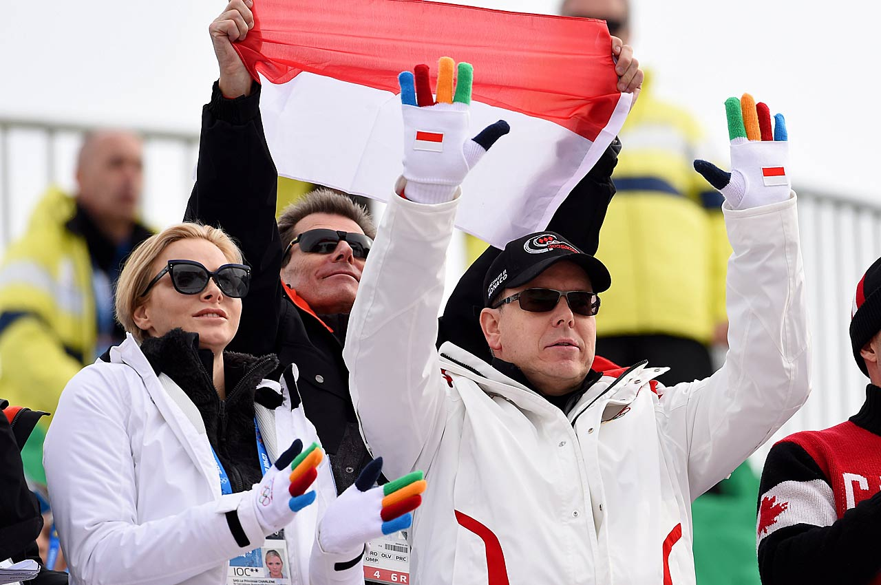 Prince Albert II of Monaco and Princess Charlene of Monaco cheer as Arnaud Alessandria of Monaco skis during the men's downhill.