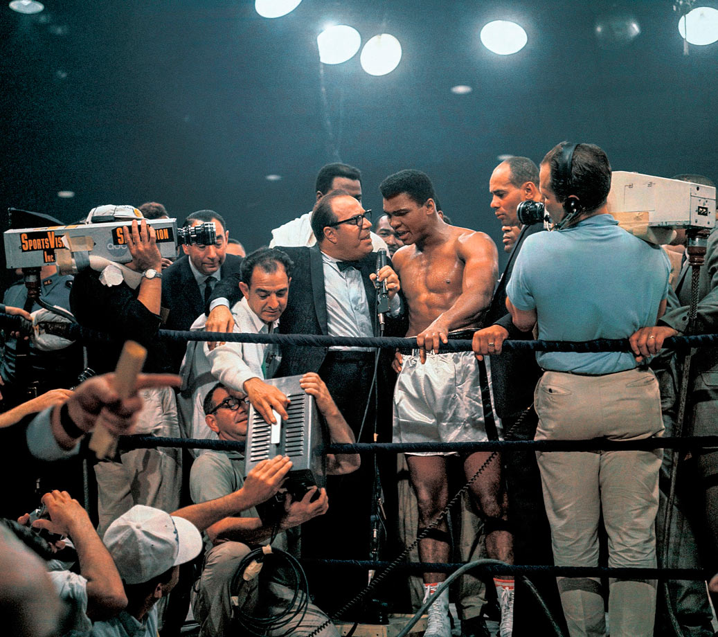 As Ali held forth, future foil Howard Cosell lurked behind the TV camera.