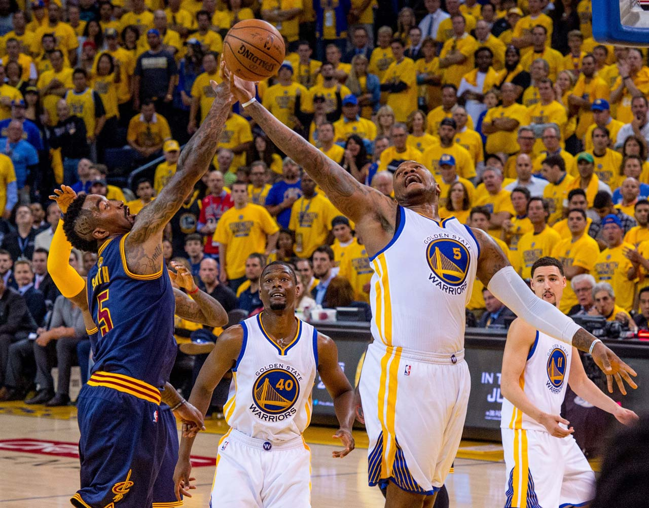 Marreese Speights of Golden State keeps the ball away from J.R. Smith. Speights scored eight points in nine minutes and had two rebounds.