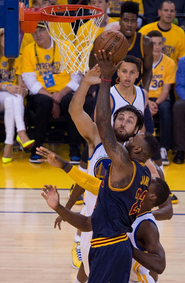 Andrew Bogut attempts to stop LeBron James.