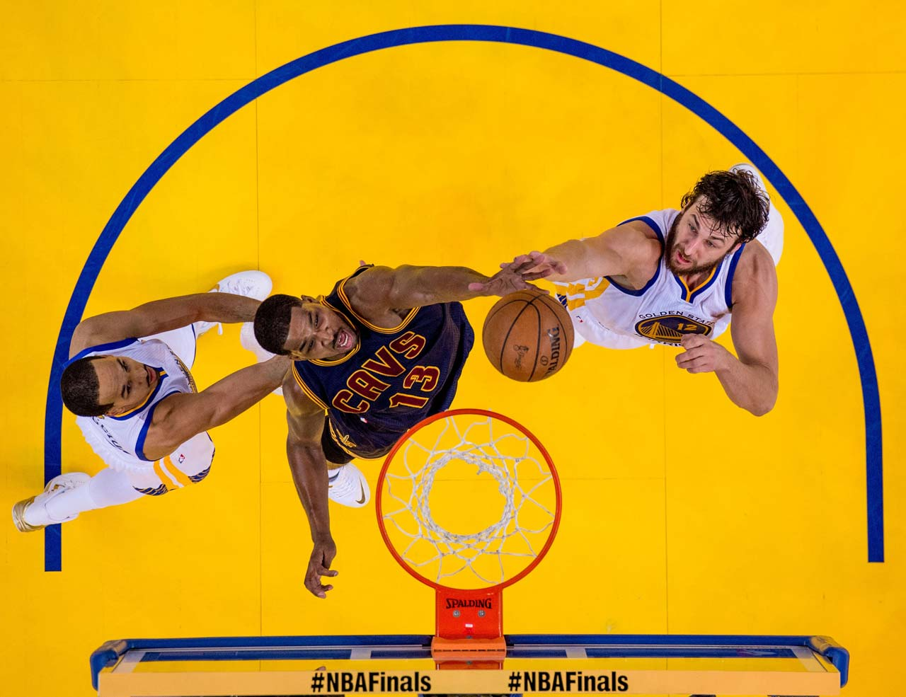 Cleveland center Tristan Thompson and Golden State center Andrew Bogut battle for the ball.