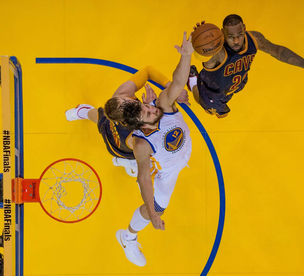 Andrew Bogus battles LeBron James for a rebound. Bogut finished with 10 on the night while James pulled down 16.