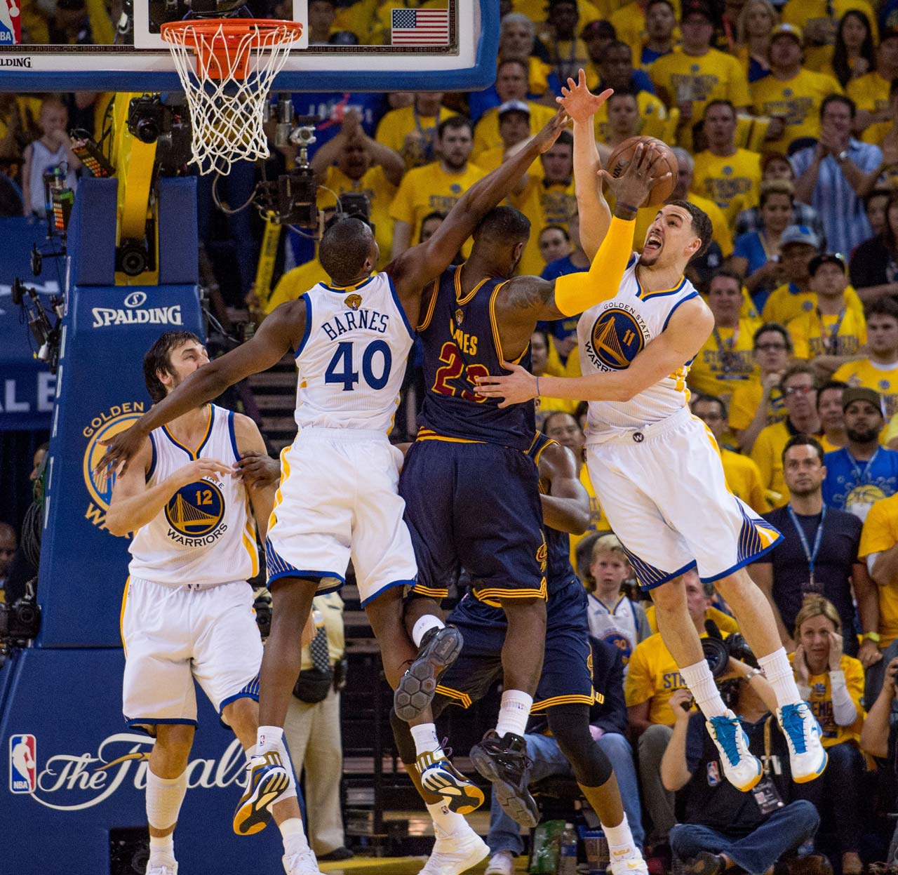 Harrison Barnes and Klay Thompson do their best to try to slow down LeBron James.