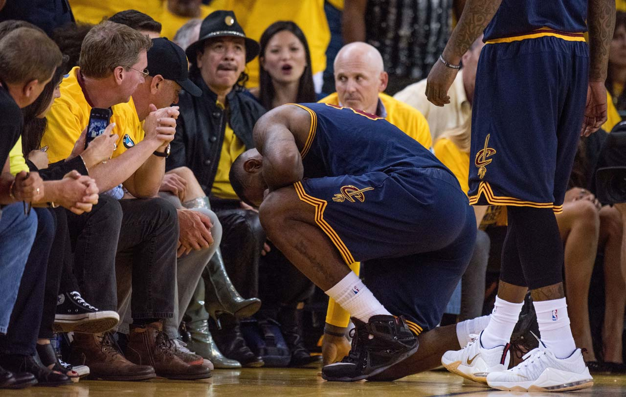 LeBron James took longer than usual to compose himself after getting hit across the nose by Draymond Green on a hard foul in the fourth quarter.