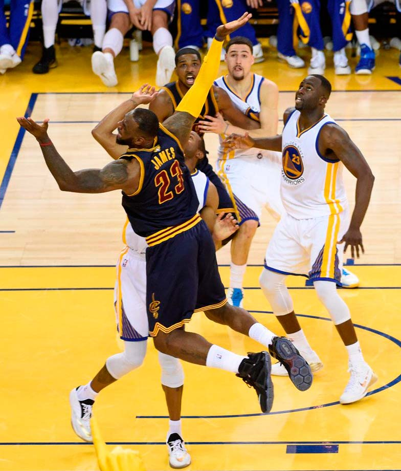 LeBron James got raked across the arm on this sequence but no foul was called.