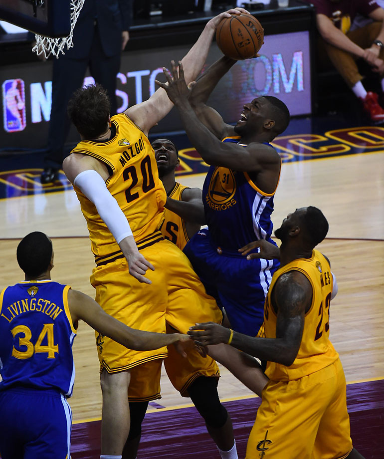 Timofey Mozgov blocks a shot by Festus Ezeli.