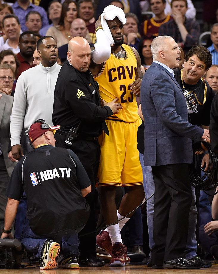 LeBron James suffered several cuts to his head after crashing into a cameraman. James hit only four of his 14 shots after that.