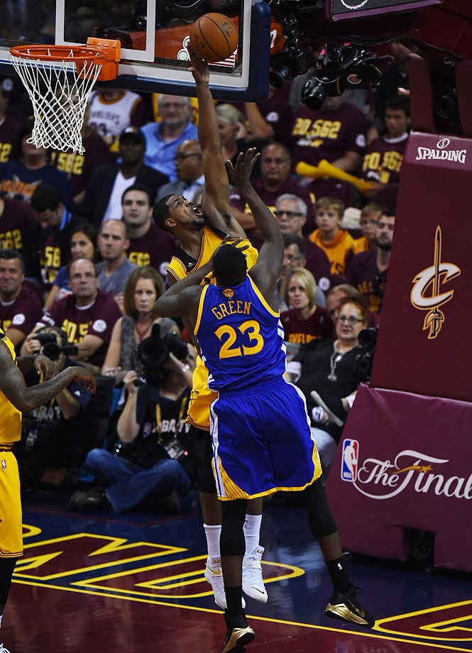 Tristan Thompson blocks a Draymond Green shot.