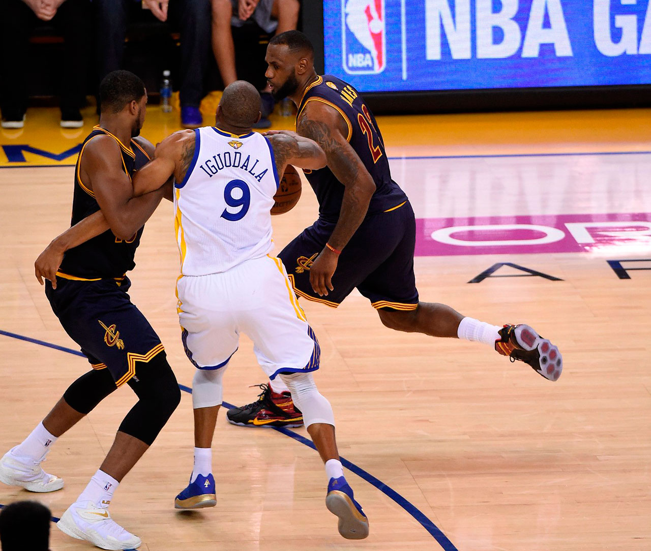 Tristan Thompson keeps Andre Iguodala from defending LeBron James.