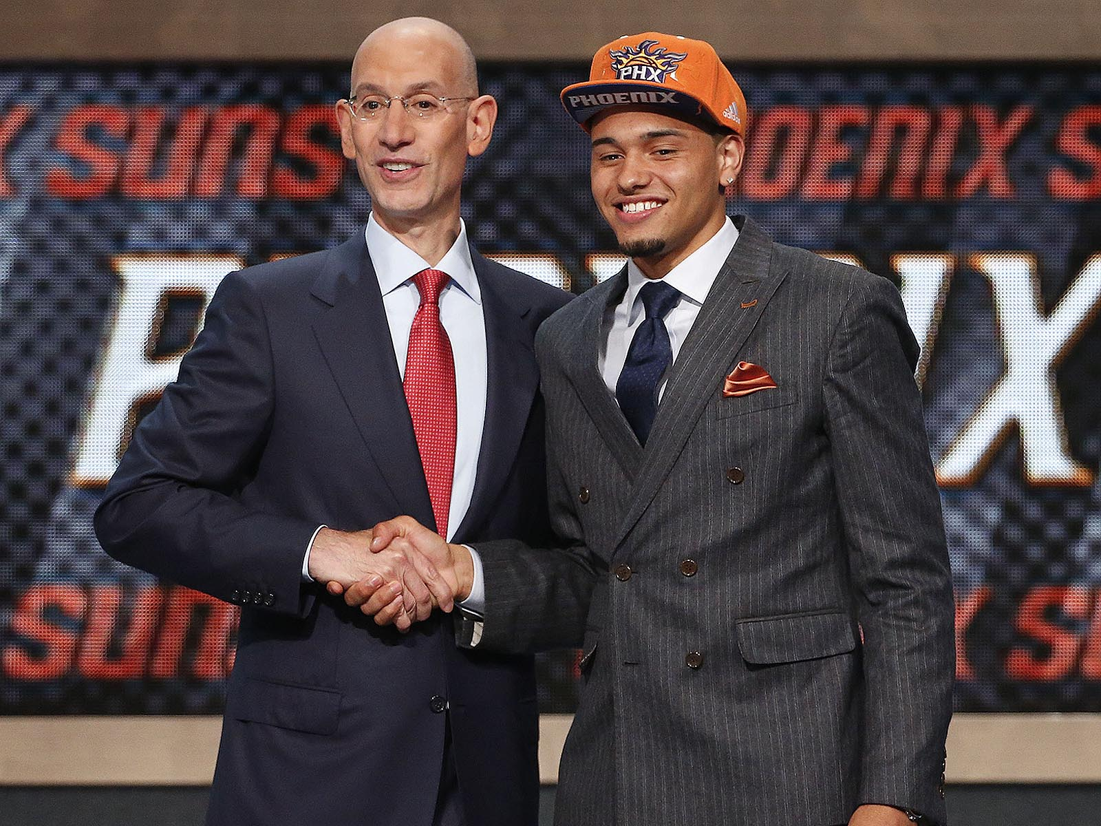 Not only does Ennis match the Suns orange with his pocket square, but the ex-Orange stands apart with a trendy double-breasted suit.