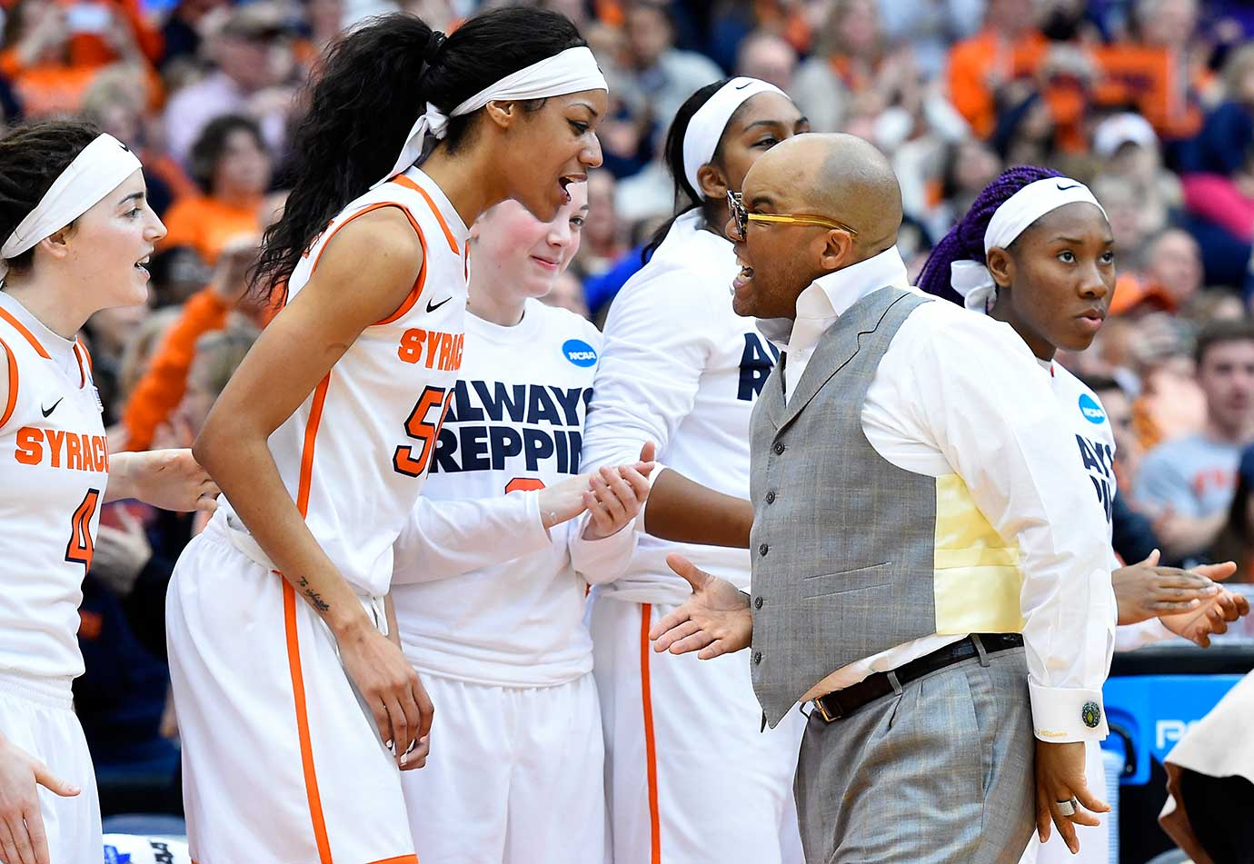 Briana Day and Syracuse head coach Quentin Hillsman celebrate their 76-59 win over Albany in the NCAA Tournament.