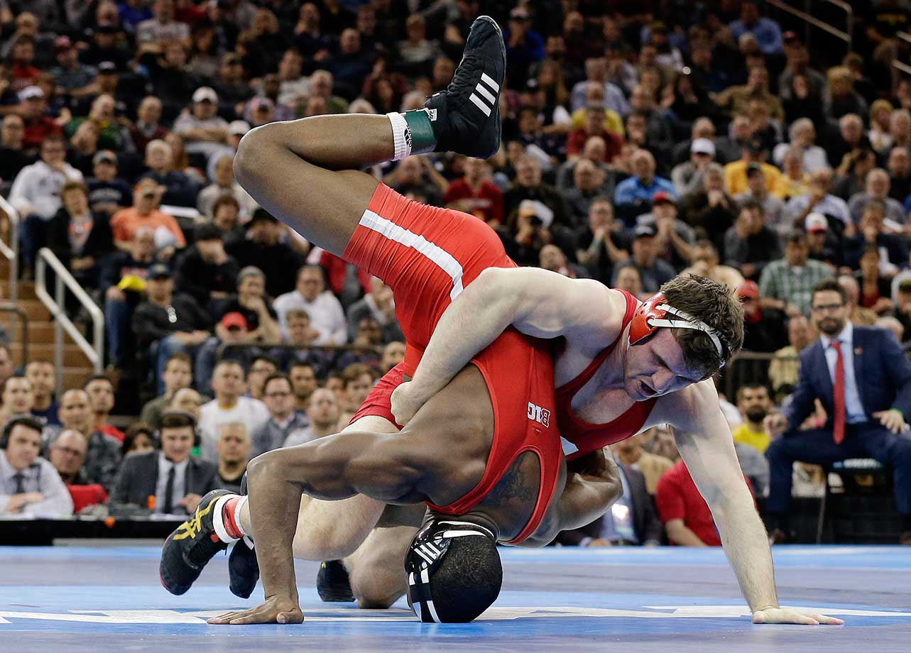 Cornell's Gabriel Dean takes down Timothy Dudley in the 184-pound championship match of the NCAA Division I Wrestling Championships. Dean won the match.