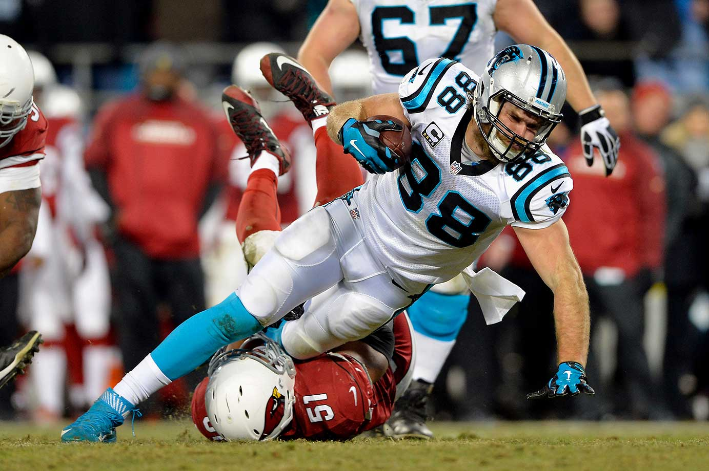Greg Olsen gets pulled down by Kevin Minter but not after picking up some key yardage.