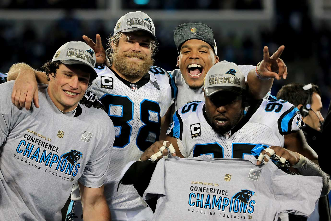 Luke Kuechly, Greg Olsen, Cam Newton and Charles Johnson celebrate a win that earned them a trip to Super Bowl 50.