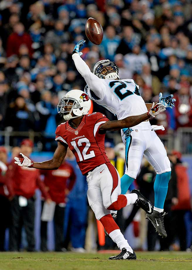 Robert McClain misses an interception while defending against John Brown.