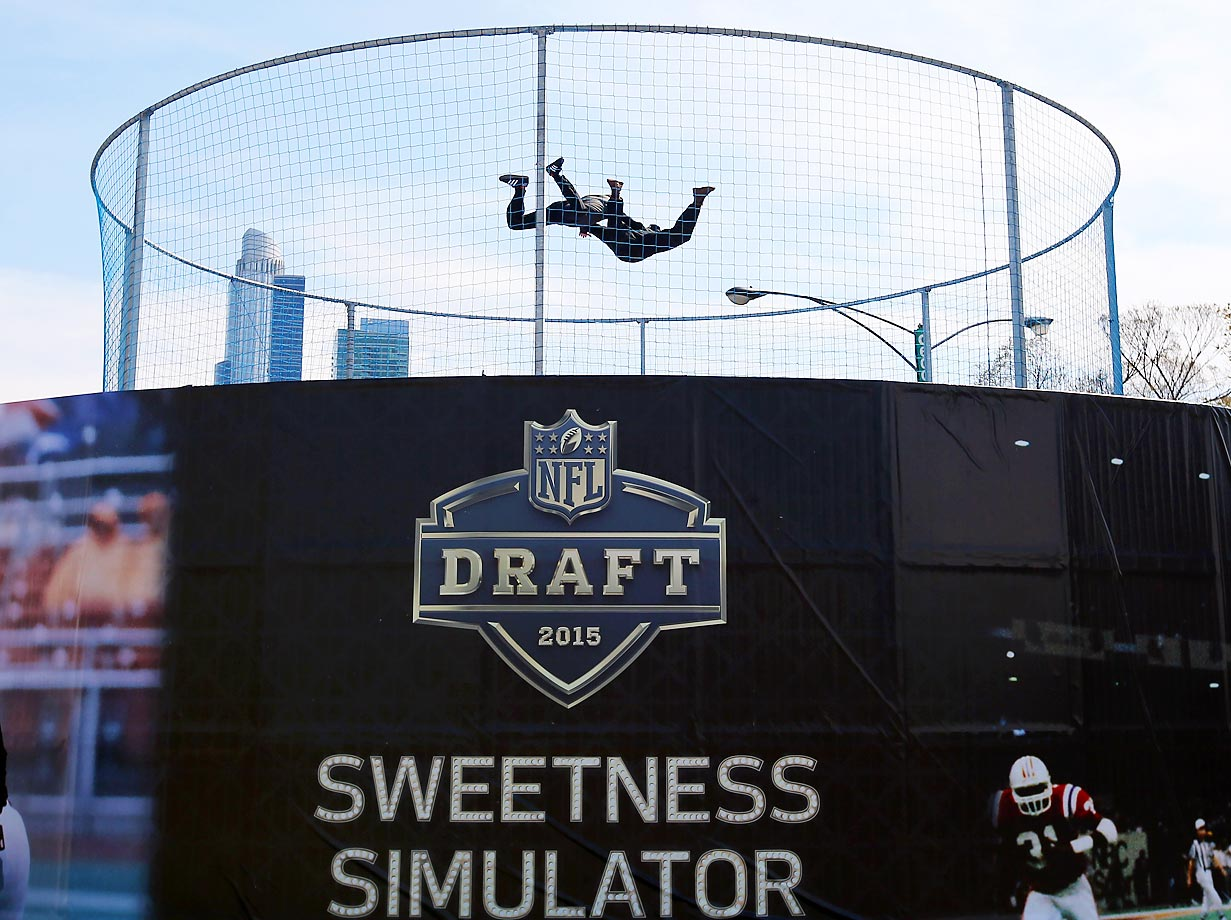 People floating in air over the Sweetness Simulator at the NFL Draft Town.