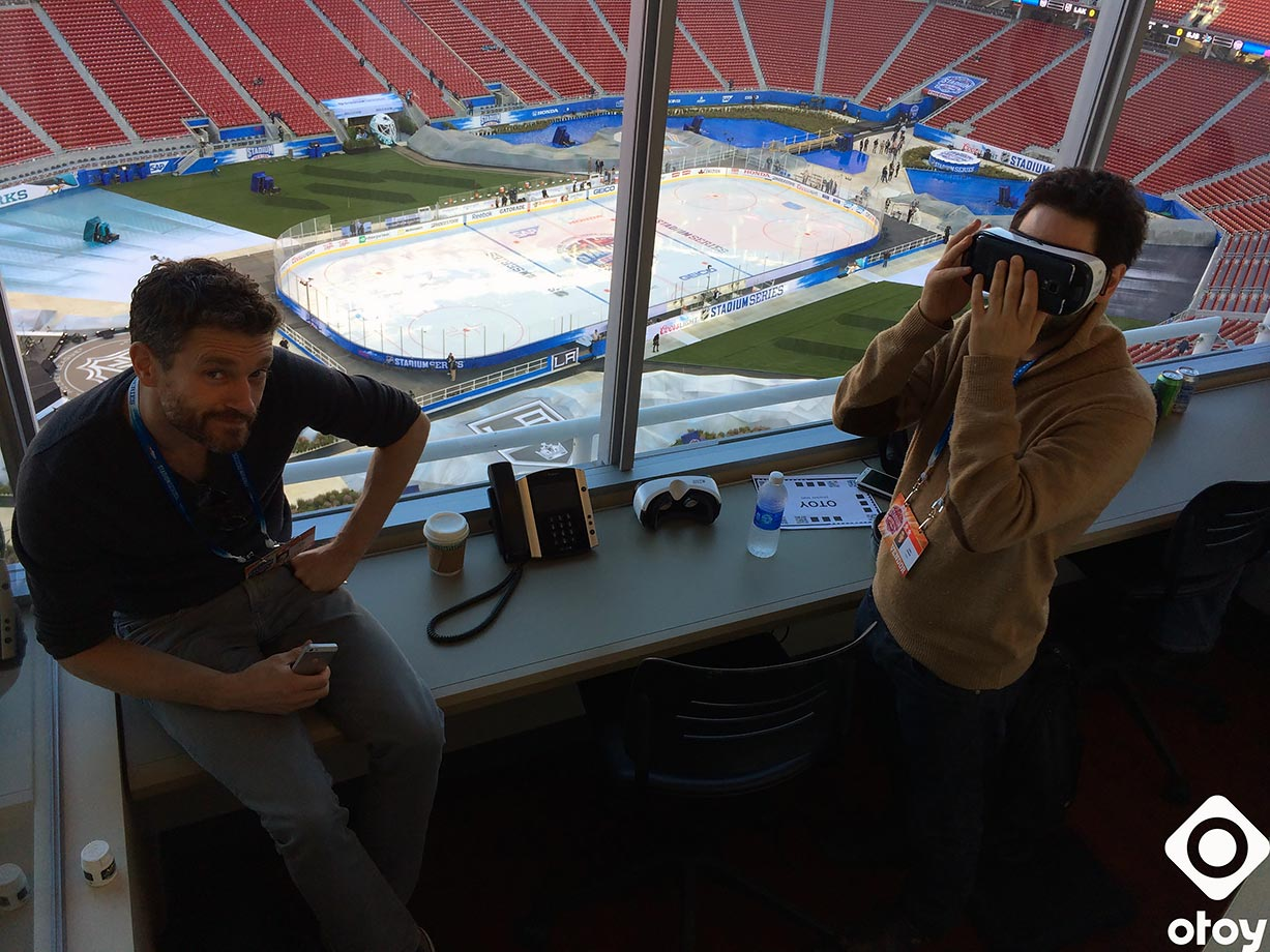 OTOY CCO Clay Sparks sits with CEO Jules Urbach wearing a virtual reality on Feb. 26, 2015 before the Stadium Series game between the Los Angeles Kings and San Jose Sharks at Levi's Stadium in Santa Clara, Calif.