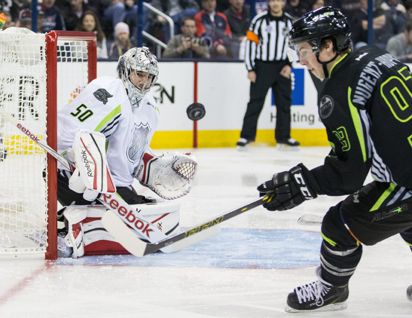 Ryan Nugent-Hopkins #93 of Team Foligno attempts to control the puck in the air as Team Toews goaltender Corey Crawford watches during the 2015 NHL All-Star Game.