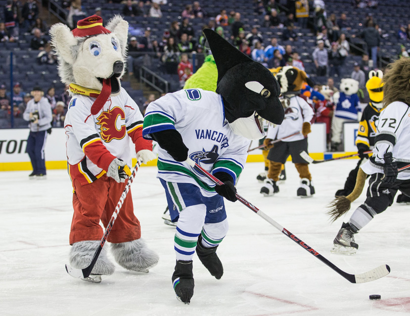 Vancouver mascot Fin the Whale skates with the puck during the inaugural NHL All-Star Mascot Showdown.