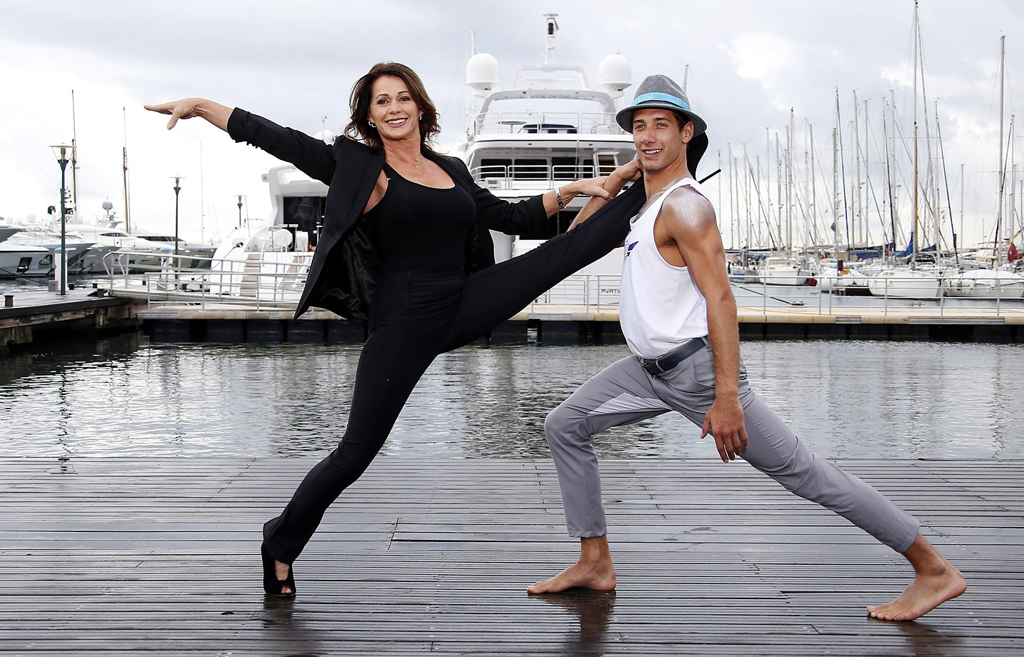 "Nadia Comaneci poses during a photocall for the TV show ""Tumble"" as part of the MIPCOM trade fair in Cannes."