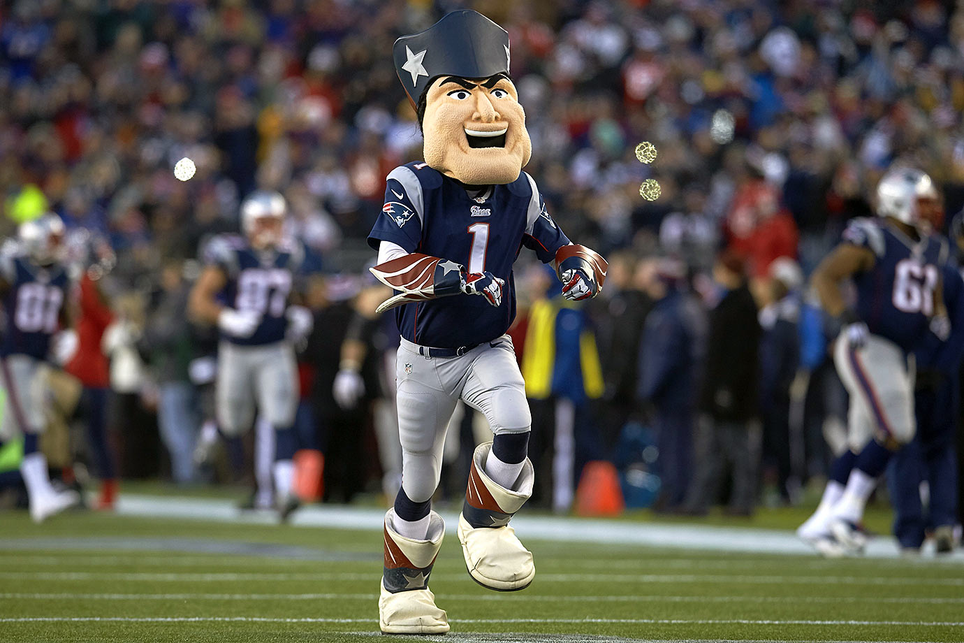 The real Pat the Patriot was a center for the old New England Patriots (which explains why the Bears defensive line destroyed the Patriots in Super Bowl XX). This Pat the Patriot is a muppet-like version that is obviously allergic to bee-stings and regularly inflated balls.