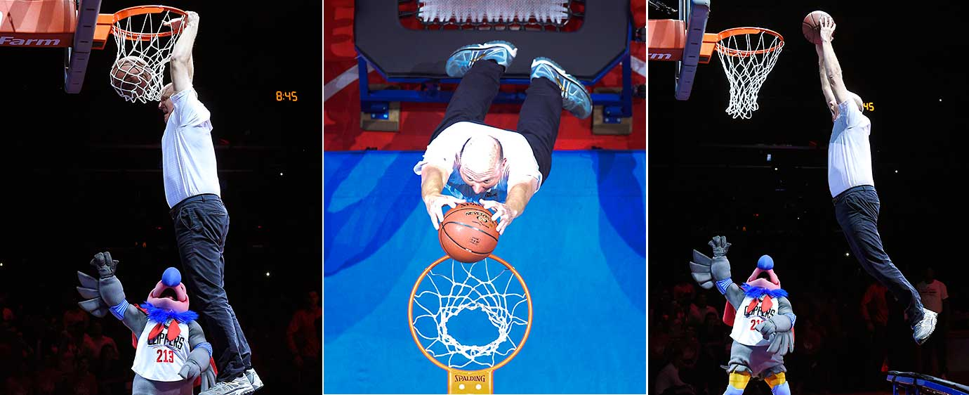 Clippers owner Steve Ballmer does a trampoline-assisted dunk after introducing his team's new mascot, a California Condor named Chuck.