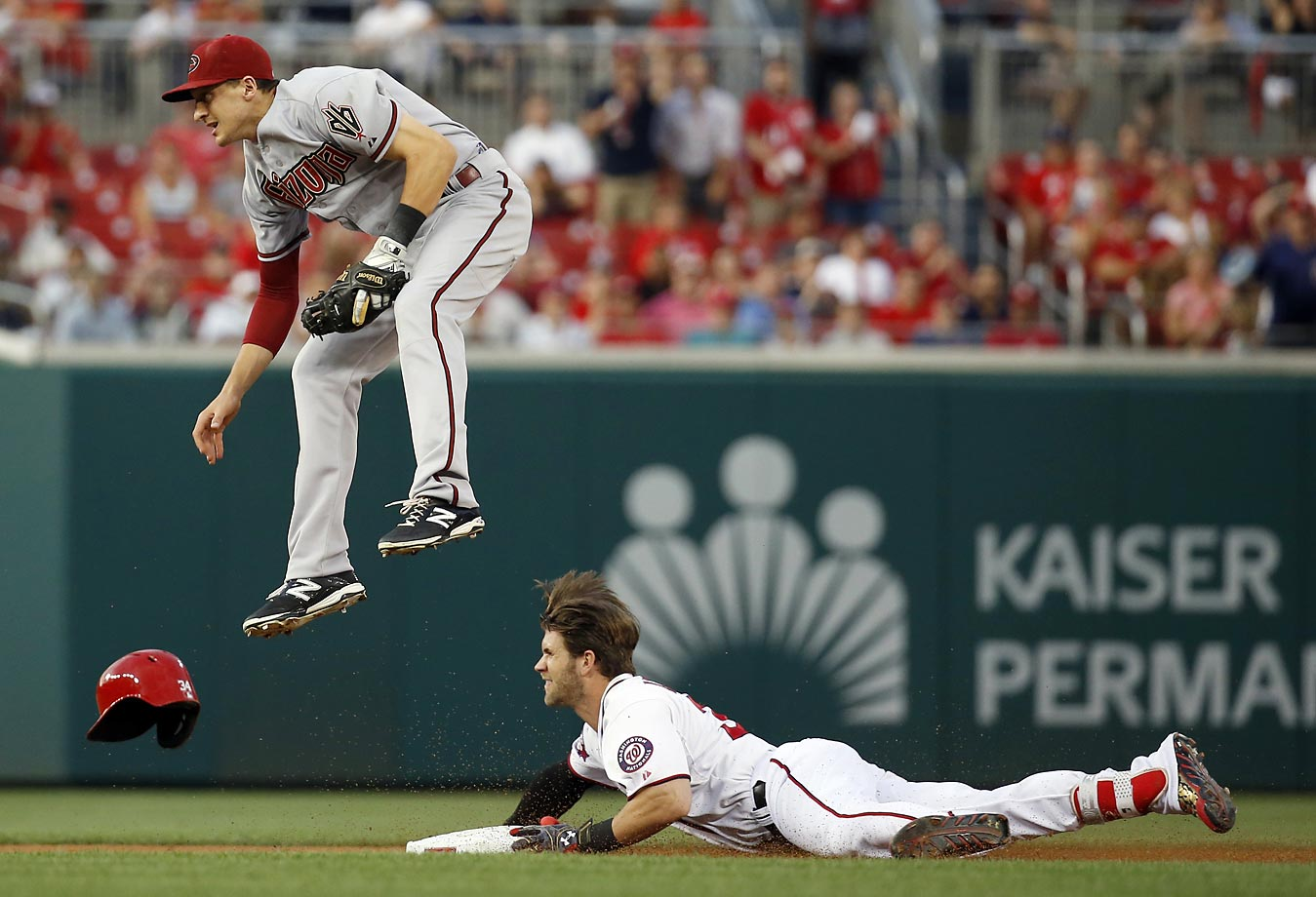 Bryce Harper of the Washington Nationals slides in safe under Nick Ahmed of the Arizona Diamondbacks.
