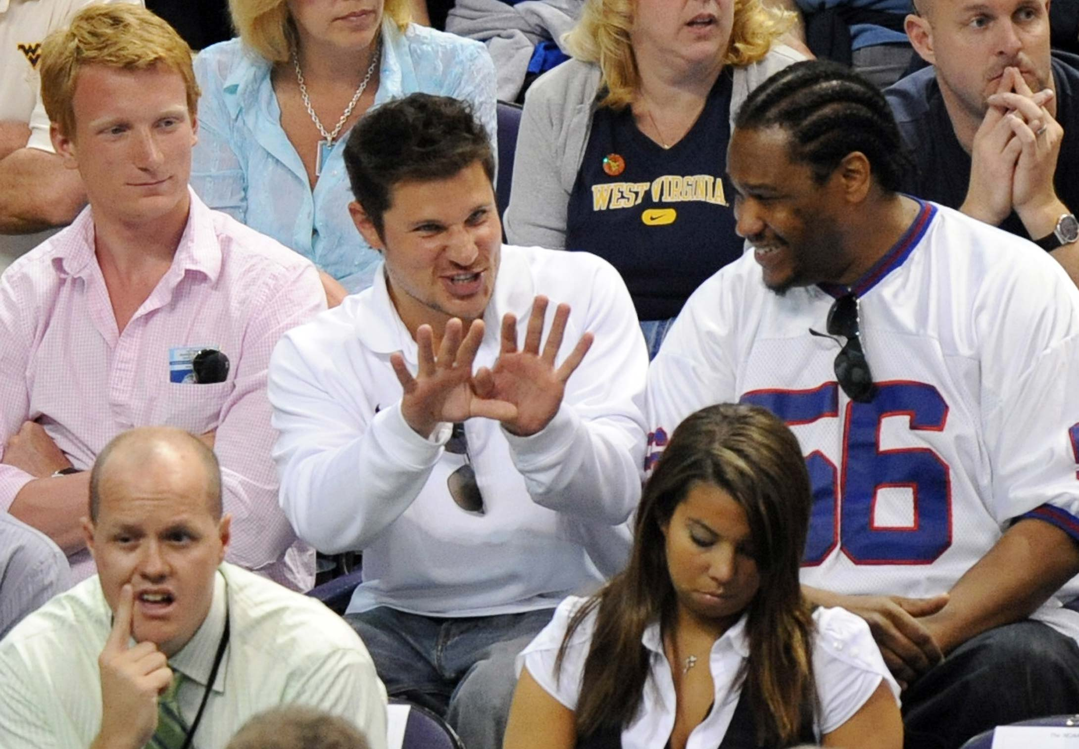 Nick Lachey watches West Virginia face Xavier during a 2008 West Regional semifinal in Phoenix.