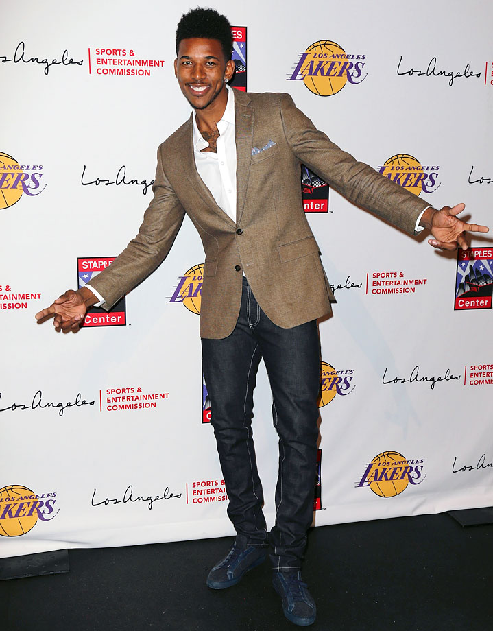 Nick Young is making a strong case for the return of pocket-squares into everyday life in this effortlessly-cool ensemble.