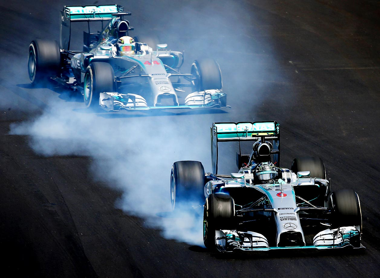 Nico Rosberg of Germany and Mercedes GP locks up in front of Lewis Hamilton of Great Britain and Mercedes GP during the Brazilian Formula One Grand Prix.